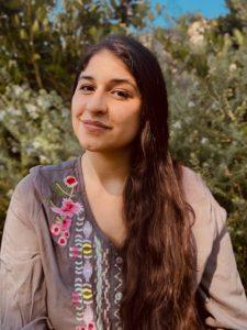 Headshot of Leslie Arreola-Hillenbrand